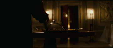 Dark Knight Rises Trailer Analysis: Christian Bale (as Bruce Wayne) with an obvious limp and walking cane.